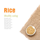 Whole unpolished organic rice in bowl isolated on white poster