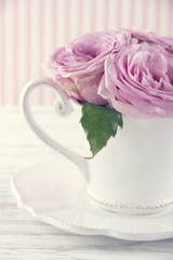 Cup filled with a bouquet of romantic pink roses3