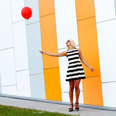 Happy woman  with colorful latex balloon.