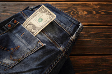 Creative composition of Money on the jeans