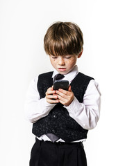 Emotional red-haired boy with mobile phone