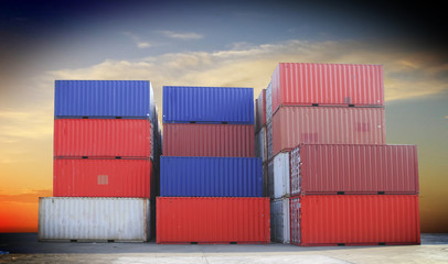 Stacked cargo containers in storage area of freight sea port ter