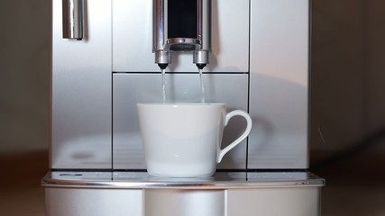Coffee maker pouring hot water.