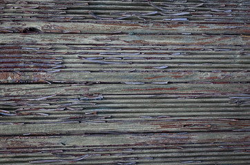Cracked paint on a wooden wall. Wall from wooden planks with