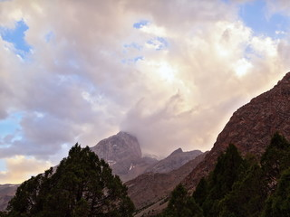 Peaks in the clouds at sunset. Pamir, Tajikistan. 4x3