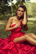 Young beautiful bride wearing red dress