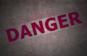 Steel plate background with danger text.