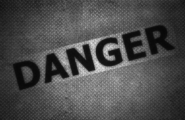 Steel plate background with danger text, Black and white.