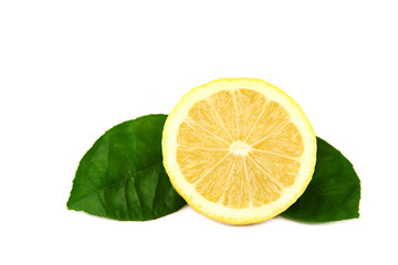 Fresh lemon with green leaves.