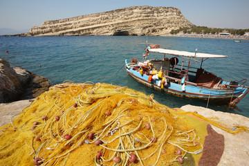 Matala beach with fishing boat in Crete. Greece