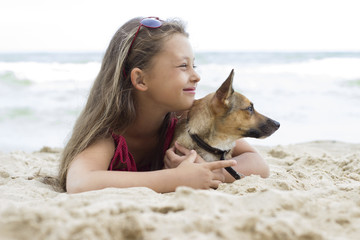 Child and puppy on the sea