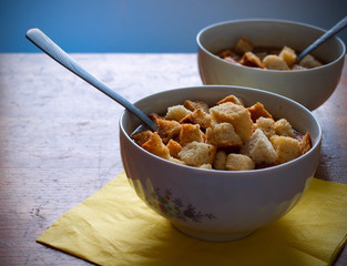 Bowls of vegetables soup with croutons
