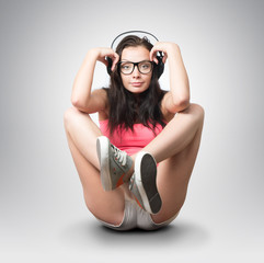 Young girl in an extravagant pose with headphones