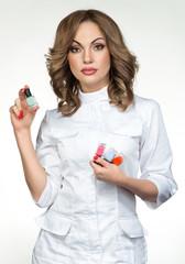 Manicure master holding nail polish