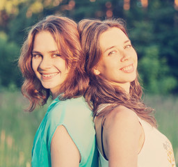 portrait of two beautiful young women friends