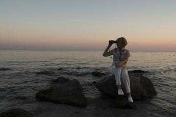 woman is looking to the binocular