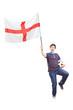 Football fan holding an English flag