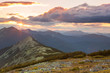 Panorama of Mountains -  sunset time. Beautiful peaks, clouds an