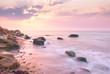 Sunrise landscape over beautiful rocky coastline in the Sea