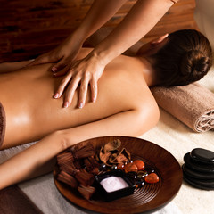 Masseur doing massage on womans back.