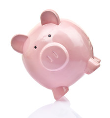 Piggy bank balancing on white background