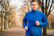Man jogging in early spring nature