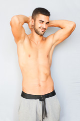 Handsome man half naked on white background