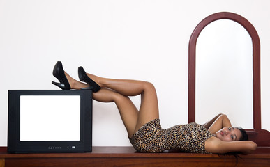 attractive woman with a television