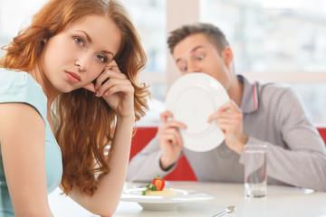 man licking plate after finishing lunch.