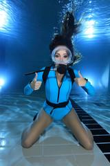 Female scuba diver show hand signal