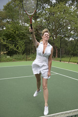 Female tennis player in action on a court