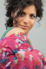 Beautiful woman with brown eyes with a silk scarf