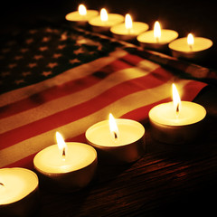 flag of the United States and lighted candles