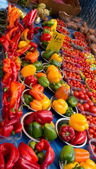 Market stall, London, UK. Fresh vegetables - peppers, tomatoes,