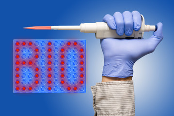 Microbiological pipette on blue background