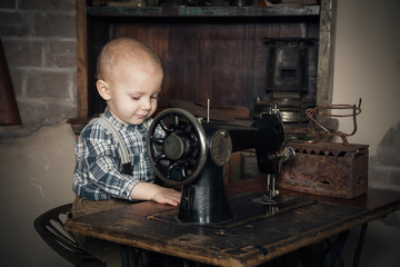 boy playing with sewing-machine