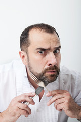Man with a fork and knife