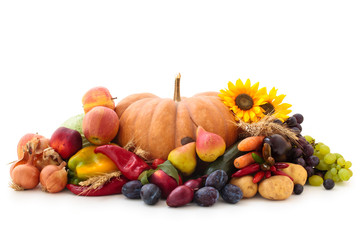 Autumnal fruits and vegetables isolated on white.