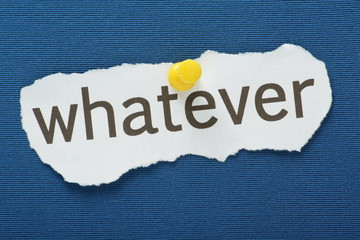 The word Whatever pinned to a blue notice board