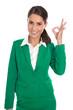 Handzeichen Qualität: Attraktive Geschäftsfrau in Grün