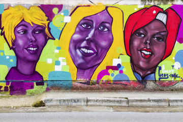 Colorful murals of the woman faces
