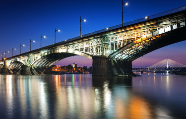 Two bridges illuminated in Warsaw