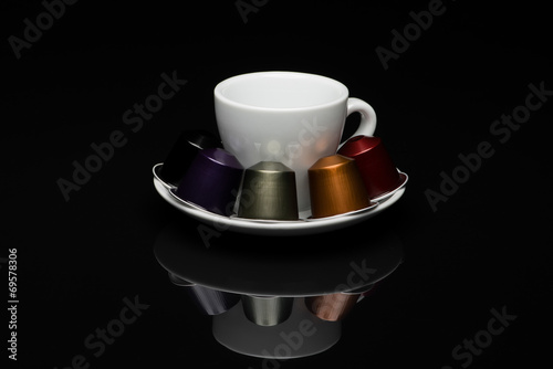 Cup of coffee with capsules