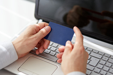 Male hands holding credit card