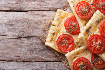 Puff pastry pies stuffed with cheese and tomato top view