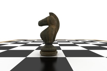 Black knight on chess board