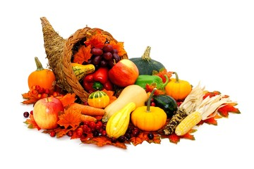 Thanksgiving cornucopia filled with fresh harvest vegetables