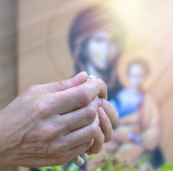 Praying with rosary in hands