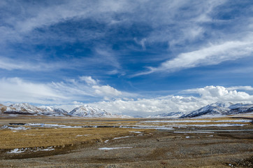Amazing view of high altitude Tibetan plateau and cloudy sky