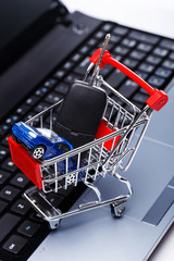 Car and key in shopping trolley